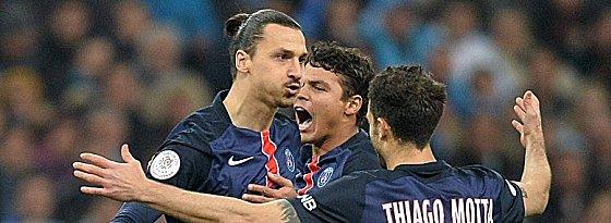 In der Ligue 1 eine Klasse für sich: Paris St. Germain mit Zlatan Ibrahimovic, Thiago Silva und Thiago Motta (v.l.).