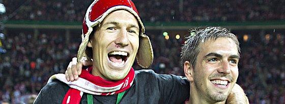 Bekamen die meisten Stimmen der Bundesliga-Fraktion: Arjen Robben (10) und Philipp Lahm (8, re.).