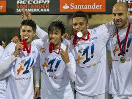 Santos mit Medaillen