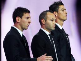 Spannender Dreikampf um den Goldenen Ball: Lionel Messi (li.), Andrés Iniesta und Cristiano Ronaldo (re.).