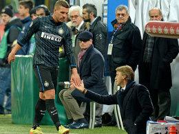 Lukas Podolski (li.)