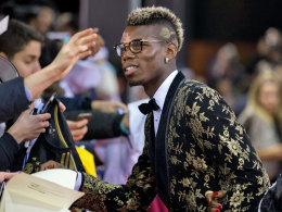 Wenn Messi nicht auffallen will, macht es eben er: Juves Paul Pogba trägt gewagtes Gold.