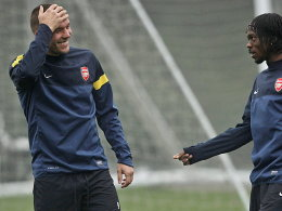 Lukas Podolski (li.) und Gervinho