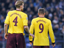Per Mertesacker und Lukas Podolski