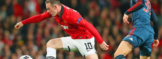 Wayne Rooney, hier gegen den Münchner Toni Kroos, droht im Rückspiel auszufallen.