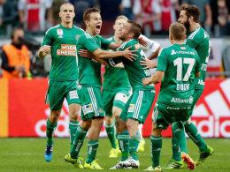 Rapid im Freudentaumel: Die Wiener kegelten Ajax aus der CL-Qualifikation - und könnten nun auf Leverkusen treffen.