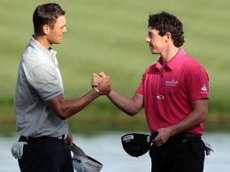 Martin Kaymer (li.) gewann 2010 in Dubai, ist diesmal aber nur Außenseiter. Bessere Chancen kann sich Rory McIlroy (re.) ausrechnen.