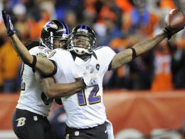 Halbfinale! Baltimores Jacoby Jones feiert seinen Touchdown.