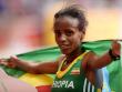 �bergl�cklich: Die �thiopierin Mare Dibaba hat den spannendsten Frauen-Marathon der WM-Geschichte gewonnen.