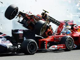 Lebensgefährlich: Romain Grosjean fliegt mit seinem Lotus über den Ferrari von Fernando Alonso.