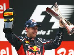 Strahlender Sieger: Red-Bull-Pilot Sebastian Vettel feiert seinen vierten Sieg in Folge.