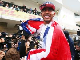 Strahlender Weltmeister: Der britische Mercedes-Pilot Lewis Hamilton.