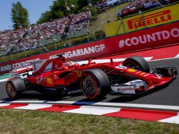 Vettel feiert Zittersieg vor Räikkönen