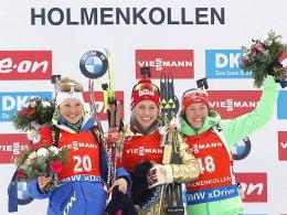 Marie Dorin Habert, Tiril Eckhoff, Laura Dahlmeier (v.li.)