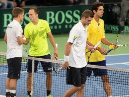 Martin Emmrich (ganz li.) und Daniel Brands konnten gegen das brasilianische Doppel nicht den dritten Punkt machen.