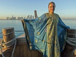 Angelique Kerber vor der Skyline von Doha.
