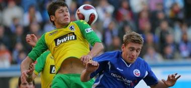 """Teilten sich die Punkte: Rostocks Christian Rahn (re.) und """"Löwe"""" Mate Ghvinianidze."""